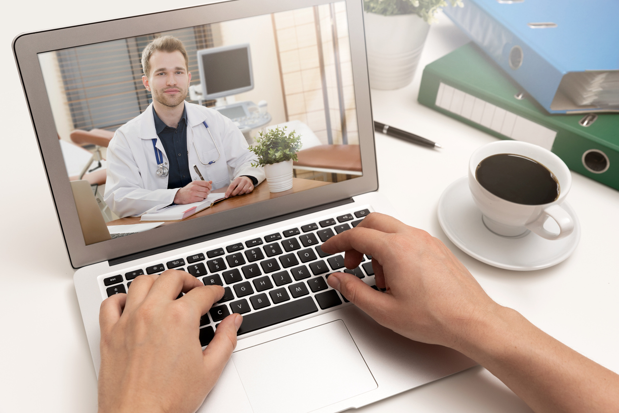 Doctor-with-a-stethoscope.-Telemedicine-concept-1096860350_1256x838